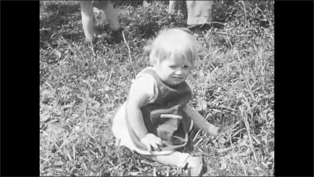 1940s: UNITED STATES: children play volleyball. Displaced person nursery. Children orphaned in war. Babies in nursery