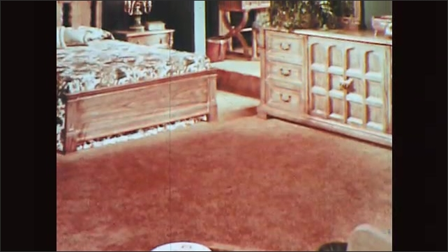 1970s: Interiors of rooms and office with wood furniture and features.