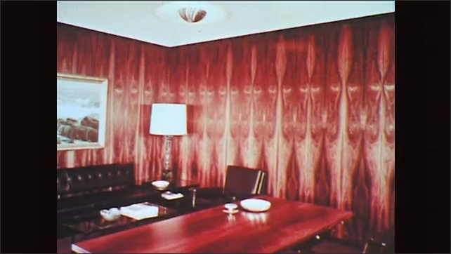 1970s: Interiors of rooms and office with wood furniture, features and paneled walls.