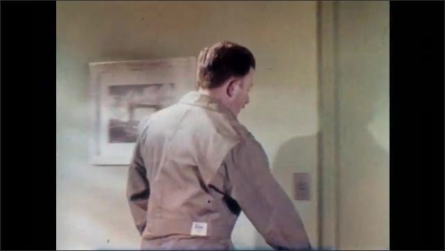 1950s: Man sitting in office, stands and exits. Man shuts door, talks to self.