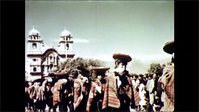 1960s: People walk in a procession next to a church. Faces of people.