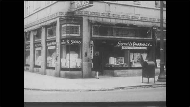 1940s: Pharmacist in chemistry lab writes on paper and labels jar. Store sign says Drugs. Woman walks into drugstore. People walk around street corner in front of drugstore.