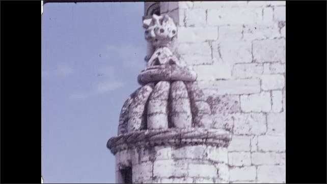 1960s: PORTUGAL: EUROPE: waves on shore by castle. Stone fortress. Stone tower. People look through window of tower