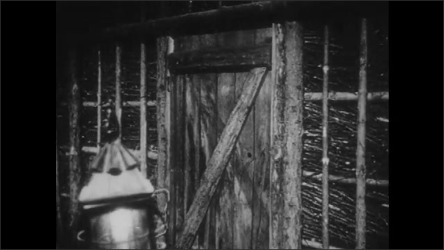 1950s: Two men walk out door, man pauses, looks back. Closed door.