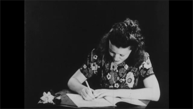 1940s: UNITED STATES: book of forestry. Lady reads book about forestry. Lady writes notes in book. Chimney against clouds and sky