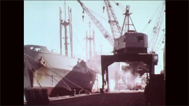 1960s: Three men do trick waterskiing. Shipping boats in harbor. Cargo is loaded onto docked shipping vessel. Tug boat pushes barge.