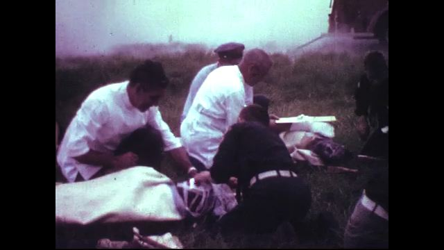 Health care workers tend to the victims of a plane crash.