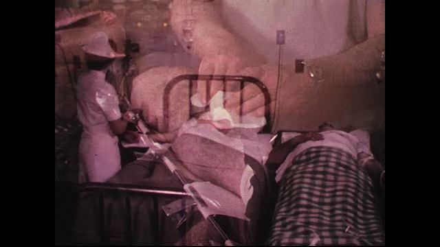 A nurse cares for plane crash victims in a temporary ward.