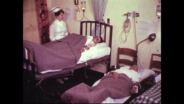 Nurses check the vital signs of two plane crash victims situated in their ward.