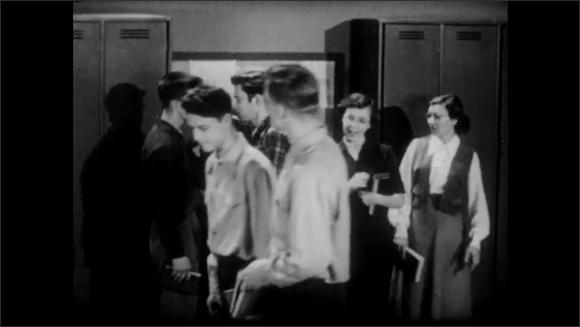 1950s: Young men and women mill around lockers and bulletin board, talking, then walk away.