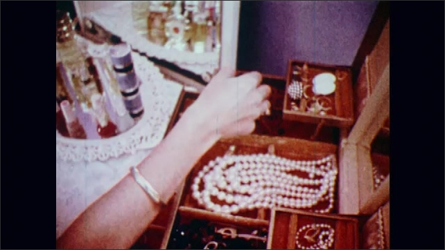 1970s: UNITED STATES: Close up of seeds in garden. Rosary pee. Jewelry made from seeds.