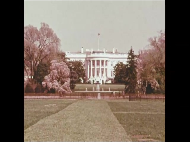 1970s: US Capitol building. White house. Satellite in space.