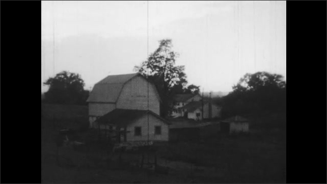 1940s: Exterior of school. View of farmhouse, barn.
