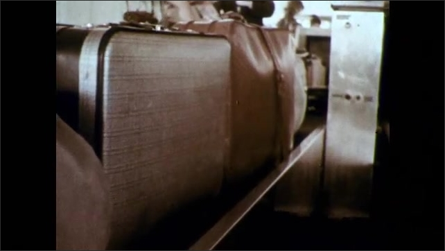 1960s: Fashionable woman enters airport. Airport luggage on conveyor belt. Bolt of fabric being conveyed through manufacturing plant.