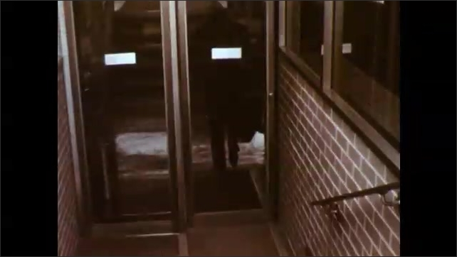 1960s: Train moving down tracks. Airplane taking off of runway. Boy sliding down bumpy playground slide. Businessman ascending staircase. Woman walking through room.