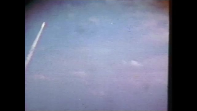 1980s: UNITED STATES: space craft takes off. Man with camera. People watch space launch. Press watch launch. Smoke in sky