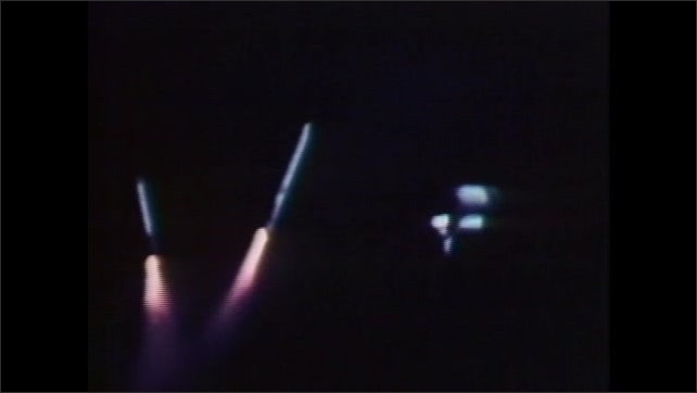 1980s:  Space shuttle disengages from tanks.