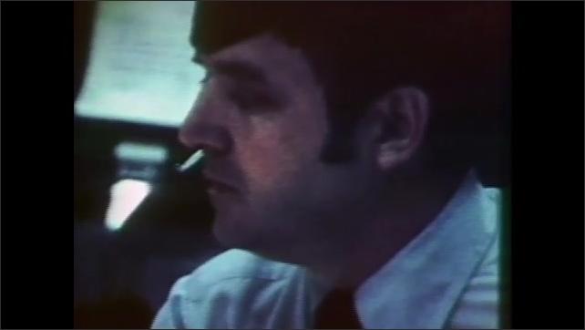 1980s: Spacecraft.  Mission control.  Man speaks.