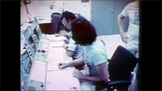 1980s: Mission control room.  People study data.