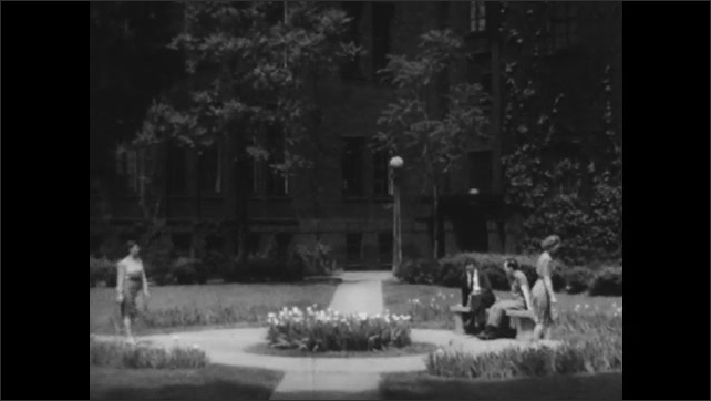 1940s: Girls with good posture walk smoothly across a courtyard.