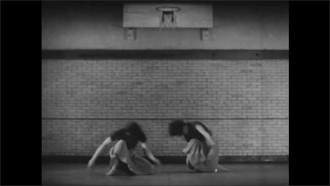 1940s: Two men play handball on court. Two women perform modern dance moves in synch. Two men hike a mountain with backpacks.