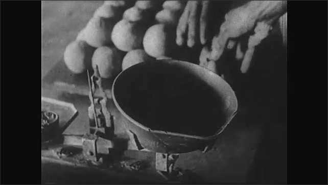 Africa 1940s: Man places balls of clay into scale. Man removes clay ball from scale and adds to stack. Man throws ball of clay onto center of rotating potter's wheel.