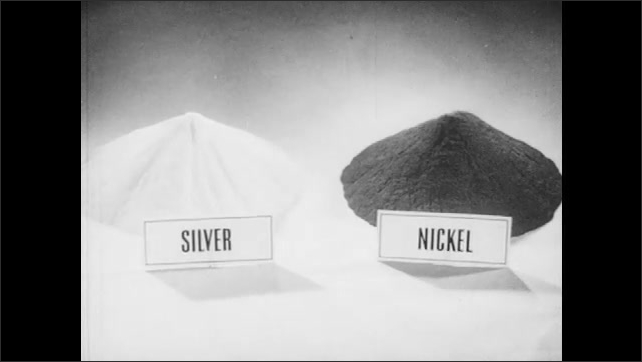 1940s: Two blocks with labels ????ilver????and ????ickel???? the blocks become piles of raw material of metal powder. Mechanical device moves. Man inspects high voltage circuit control panel.