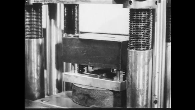 1940s: Man rotates valve, barometer points to 0. Machine moves slowly, hands take two pieces from the machine and put cylindrical spacers inside. Man turns on machine.