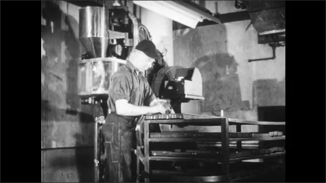 1940s: Press stamps out pieces from metal powder hopper.