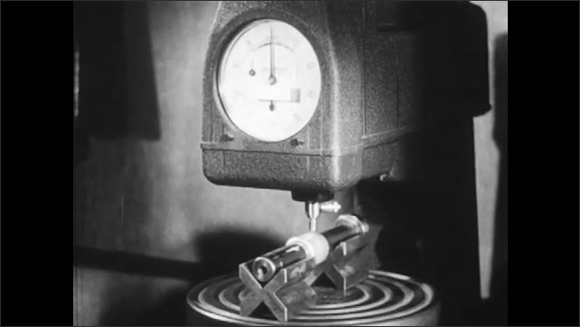 1940s: Man weighs bearings on scale, then measures the ball-bearing. Machine measures density of ball-bearing.