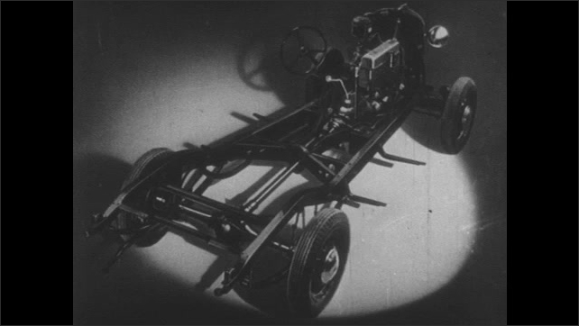 1930s: Car frame. Arrow points to different sections of engine systems as they appear. Car drives down dirt road.