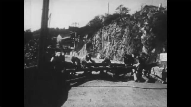 1950s: Man makes speech on street.  Crowd runs through street.  Police officers.  People on bridge.  Men throw objects in water.