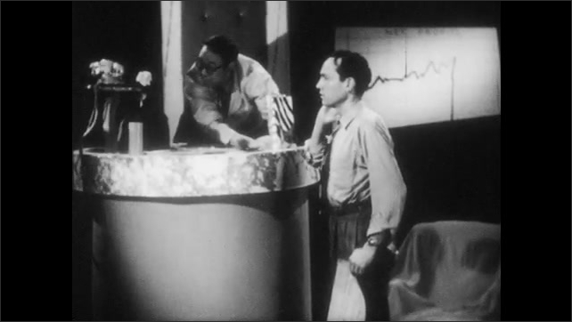 1940s: President holds out sign and man points to 1. Miscellaneous. President packs up items on desk and woman with lamp talks to man. Man sits down and shakes his head.