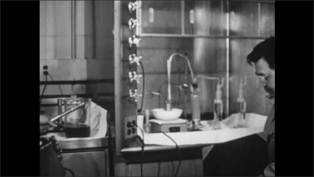 "1950s: Lab.  Man lifts window and examines experiment.  Man uses Geiger counter.  Sign reads ""DANGER!  RADIOACTIVITY."""