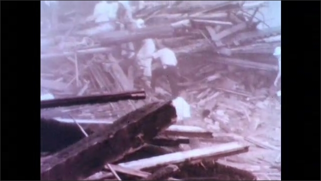 1970s: Tornado on the horizon. First responders help victims from wreckage. Emergency response drill.