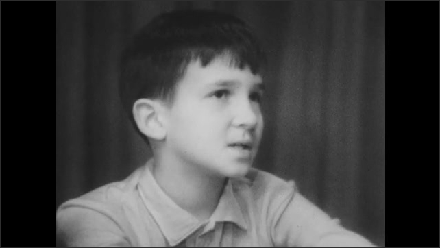 1960s: Little boy talks.
