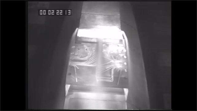 1990s: UNITED STATES: NASA plane inside wind tunnel. Man speaks to camera.