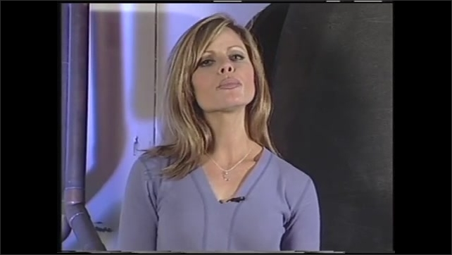 1990s: UNITED STATES: scramjet engine. Lady talks to camera. Plane in flight