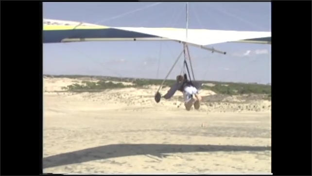 1990s: UNITED STATES: man on hang glider.