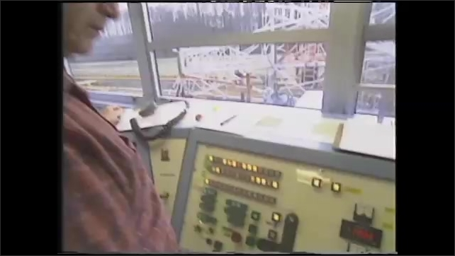 1990s: UNITED STATES: rocket takes off from launch pad. Pressurised water used to launch carriage at test centre.