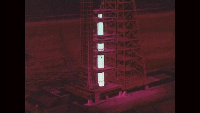 1960s: UNITED STATES: space rocket connected to tower. Animation of rocket attached to umbilical tower