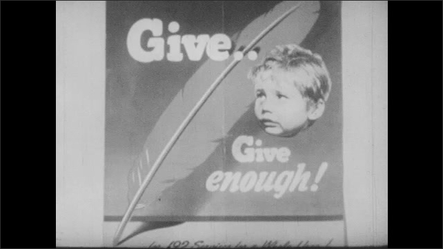 1940s: Photo of men behind barbed wire. Caption below says Nazi Concentration Camp. Poster with face of child and feather, says, Give????Give Enough! Industrial plant. Poster of American flag.
