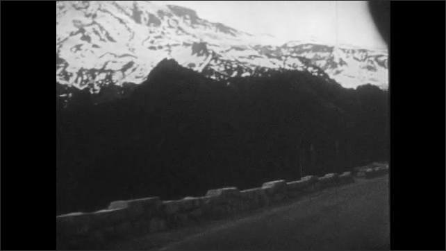 1940s: Tracking shots from car, driving on mountain road.