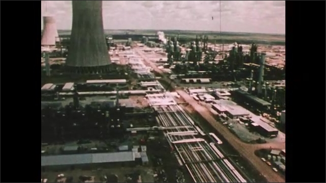 1980s: A ship harvesting kelp, its hold full.  Kelp processing plant on the shore. Overseas plant converting coal to synthetic fuels. Cooling towers and smoke stacks on the skyline.