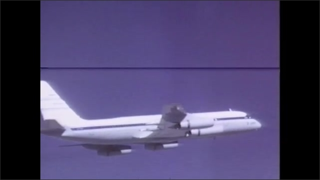 1970s: UNITED STATES: plane flies in sky. Plane trails larger plane. Wind tunnel testing of vortices