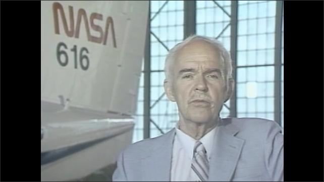 1970s: UNITED STATES: vortex pattern research. Man speaks to camera. NASA plane behind man