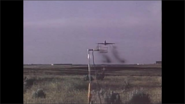 1970s: UNITED STATES: meteorologist measures weather. Man on boat measures weather. Plane flies above runway. Man records sound
