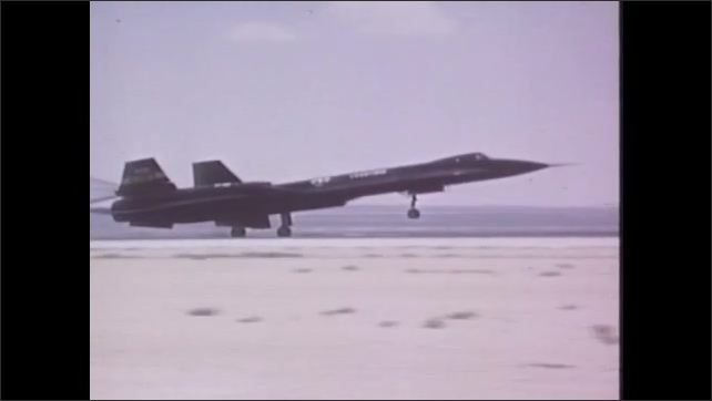 1970s: UNITED STATES: YF12 plane lands on runway. Plane takes off