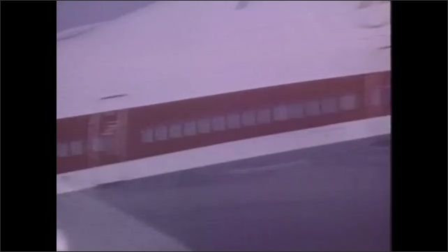 1970s: UNITED STATES: dry landing plane. Test plane lands on runway. Plane lands on wet runway in test