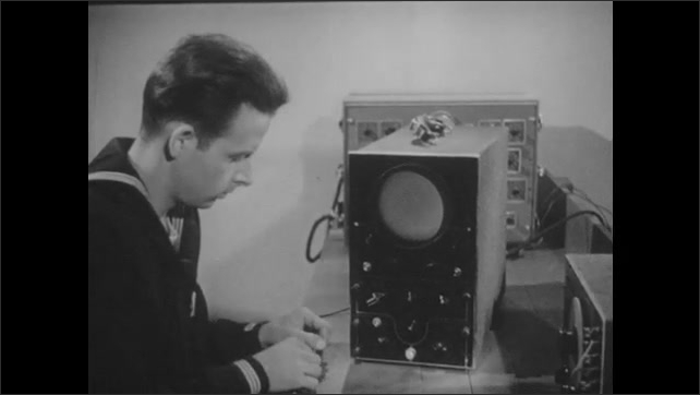 1940s: Man turns dial on machine, wave disappears from screen. Man adjusts dials on oscilloscope, remove cable, attaches new cable.